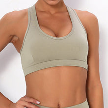 Load image into Gallery viewer, With this Ribbed Pocket Leggings & Sports Bra Set - Khaki, incorporating activewear into your everyday wardrobe makes easy. This matching workout set comes with a pair of leggings with pockets and a racerback sports bra. Individual items are available for mixing and matching. Leggings are mid-rise fitted with 2 side pockets for essentials like a phone or an ID. Racerback sport bra features a special semi-open back silhouette that helps you move your body with ease and promotes ventilation.