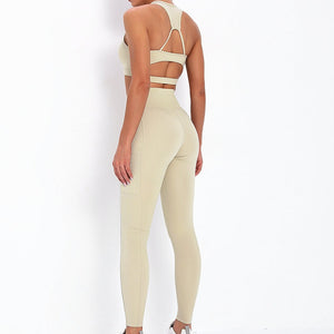 With this Ribbed Pocket Leggings & Sports Bra Set - Beige, incorporating activewear into your everyday wardrobe makes easy. This matching workout set comes with a pair of leggings with pockets and a racerback sports bra. Individual items are available for mixing and matching. Leggings are mid-rise fitted with 2 side pockets for essentials like a phone or an ID. Racerback sport bra features a special semi-open back silhouette that helps you move your body with ease and promotes ventilation.
