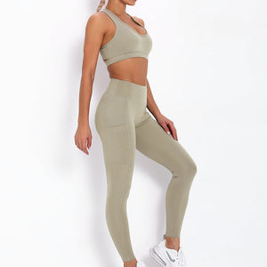 With this Ribbed Pocket Leggings & Sports Bra Set - Khaki, incorporating activewear into your everyday wardrobe makes easy. This matching workout set comes with a pair of leggings with pockets and a racerback sports bra. Individual items are available for mixing and matching. Leggings are mid-rise fitted with 2 side pockets for essentials like a phone or an ID. Racerback sport bra features a special semi-open back silhouette that helps you move your body with ease and promotes ventilation.