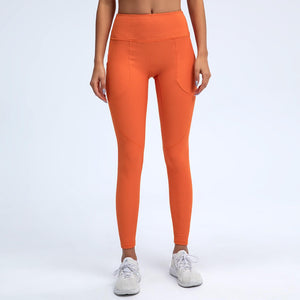 With this Ribbed Seamless Pocket Leggings & Sports Bra Set in Clementine, incorporating activewear into your everyday wardrobe is made easy. This matching workout set comes with a pair of leggings with pockets and a racerback sports bra. Leggings are mid-rise fitted with side pockets for essentials like a phone or an ID. Racerback sports bra features a scoop neckline. This cozy and textured 2 piece workout set is ideal for low to medium impact activities such as weight training and yoga.