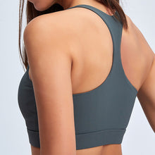 Load image into Gallery viewer, With this Ribbed Seamless Pocket Leggings & Sports Bra Set in Charcoal, incorporating activewear into your everyday wardrobe is made easy. This matching workout set comes with a pair of leggings with pockets and a racerback sports bra. Leggings are mid-rise fitted with side pockets for essentials like a phone or an ID. Racerback sports bra features a scoop neckline. This cozy and textured 2 piece workout set is ideal for low to medium impact activities such as weight training and yoga.