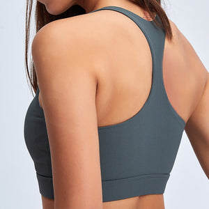 With this Ribbed Seamless Pocket Leggings & Sports Bra Set in Charcoal, incorporating activewear into your everyday wardrobe is made easy. This matching workout set comes with a pair of leggings with pockets and a racerback sports bra. Leggings are mid-rise fitted with side pockets for essentials like a phone or an ID. Racerback sports bra features a scoop neckline. This cozy and textured 2 piece workout set is ideal for low to medium impact activities such as weight training and yoga.