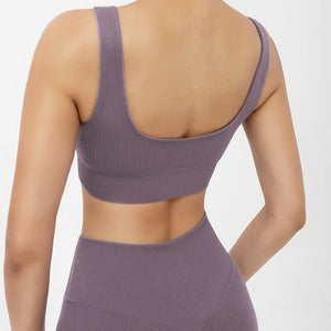 Hummingbird Pastel Classic Ribbed Seamless Sports Set - Mushy Grape containing a square neck crop tank and a pair of cropped leggings that are made of breathable wicking fabric, perfect for workout and yoga at home or at the gym.