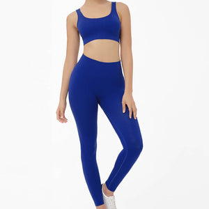 Hummingbird Pastel Classic Ribbed Seamless Sports Set - Royal Blue containing a scoop neck, low cut back crop tank and a pair of high waisted leggings that are made of breathable and wicking fabric. This matching workout set is form fitted, perfect for low impact workout and yoga at home or at the gym, and post-gym errand running.