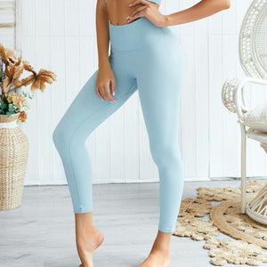 Hummingbird Pastel Classic Ribbed Seamless Sports Set - Blue containing a scoop neck, low cut back crop tank and a pair of high waisted leggings that are made of breathable and wicking fabric. This matching workout set is form fitted, perfect for low impact workout and yoga at home or at the gym, and post-gym errand running.