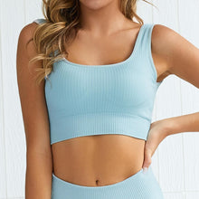 Load image into Gallery viewer, Hummingbird Pastel Classic Ribbed Seamless Sports Set - Blue containing a scoop neck, low cut back crop tank and a pair of high waisted leggings that are made of breathable and wicking fabric. This matching workout set is form fitted, perfect for low impact workout and yoga at home or at the gym, and post-gym errand running.