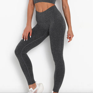 Hummingbird Pastel Classic Ribbed Seamless Sports Set - Dark Grey containing a scoop neck, low cut back crop tank and a pair of high waisted leggings that are made of breathable and wicking fabric. This matching workout set is form fitted, perfect for low impact workout and yoga at home or at the gym, and post-gym errand running.