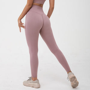 Hummingbird Pastel Classic Ribbed Seamless Sports Set - Playful Plum containing a scoop neck, low cut back crop tank and a pair of high waisted leggings that are made of breathable and wicking fabric. This matching workout set is form fitted, perfect for low impact workout and yoga at home or at the gym, and post-gym errand running.