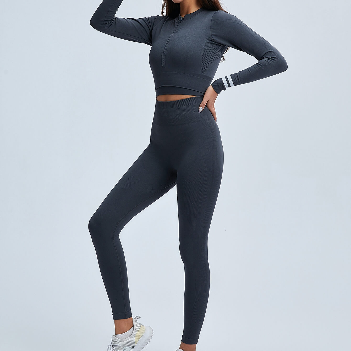 Get hyped for your workout session in this Power Up Front Zip Crop Top & Leggings Set - Charcoal. This matching workout set comes with a long sleeve crop top and a pair of leggings. Long sleeve crop top features zip up front and long ribbed cuffs with stripe details. Leggings are high-rise fitted with seamless front. This form-fitting 2 piece workout set is perfect for all sorts of activities from yoga to cardio to street.
