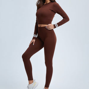 Get hyped for your workout session in this Power Up Front Zip Crop Top & Leggings Set - Russet. This matching workout set comes with a long sleeve crop top and a pair of leggings. Long sleeve crop top features zip up front and long ribbed cuffs with stripe details. Leggings are high-rise fitted with seamless front. This form-fitting 2 piece workout set is perfect for all sorts of activities from yoga to cardio to street.