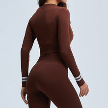 Load image into Gallery viewer, Get hyped for your workout session in this Power Up Front Zip Crop Top & Leggings Set - Russet. This matching workout set comes with a long sleeve crop top and a pair of leggings. Long sleeve crop top features zip up front and long ribbed cuffs with stripe details. Leggings are high-rise fitted with seamless front. This form-fitting 2 piece workout set is perfect for all sorts of activities from yoga to cardio to street.