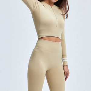 Get hyped for your workout session in this Power Up Front Zip Crop Top & Leggings Set - Beige. This matching workout set comes with a long sleeve crop top and a pair of leggings. Long sleeve crop top features zip up front and long ribbed cuffs with stripe details. Leggings are high-rise fitted with seamless front. This form-fitting 2 piece workout set is perfect for all sorts of activities from yoga to cardio to street.