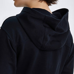 Keep yourself warm and mobile with this Solid Cotton Pullover Crop Hoodie - Black. Featuring a waist kissing cut-off hem, relaxed and dropped shoulders and cuffed wrists, this crop hoodie is a reliable piece from gym to studio to street, with its supportive fabric blend and boxy silhouette. Soft and brushed interior is skin friendly. This pullover hoodie keeps you mobile yet still warm whatever activity you are engaging in. Perfect outer layer for early spring, autumn and winter.