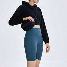 Load image into Gallery viewer, Keep yourself warm and mobile with this Solid Cotton Pullover Crop Hoodie - Black. Featuring a waist kissing cut-off hem, relaxed and dropped shoulders and cuffed wrists, this crop hoodie is a reliable piece from gym to studio to street, with its supportive fabric blend and boxy silhouette. Soft and brushed interior is skin friendly. This pullover hoodie keeps you mobile yet still warm whatever activity you are engaging in. Perfect outer layer for early spring, autumn and winter.