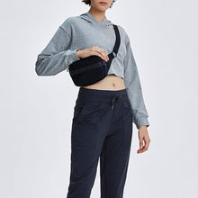 Load image into Gallery viewer, Keep yourself warm and mobile with this Solid Cotton Pullover Crop Hoodie - Heather Grey. Featuring a waist kissing cut-off hem, relaxed and dropped shoulders and cuffed wrists, this crop hoodie is a reliable piece from gym to studio to street, with its supportive fabric blend and boxy silhouette. Soft and brushed interior is skin friendly. This pullover hoodie keeps you mobile yet still warm whatever activity you are engaging in. Perfect outer layer for early spring, autumn and winter.