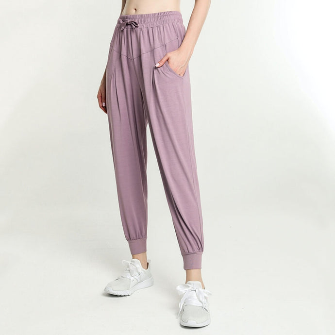 These Solid Drawstring Loose Fit Joggers - Grapesicle are great for either in studio, at the gym, at home or on the go. Featuring mid-rise, relaxed fit, ruched details and adjustable drawstring, these studio joggers are as versatile as they are comfortable. Open deep pockets can store essentials like a phone, keys, cards etc. Soft and lightweight material is breathable, moisture-wicking and dries quickly. Perfect for yoga, cardio, jogging and more.