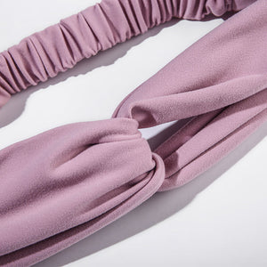 Keep bangs at bay and sweat out of eyes with this Solid Elastic Knotted Turban Headband - Pink. This softly scrunched headband offers a secure fit to hold your hair back, and along with moisture-wicking fabric, allows you to stay fresh and focused on your workout. Perfect for all sorts of workout activities including yoga, jogging, weightlifting, cardio, dancing, hiking, spinning, skating etc. Also suitable for morning makeup and nighttime moisturizing. Lightweight, breathable, stretchy and buttery soft.