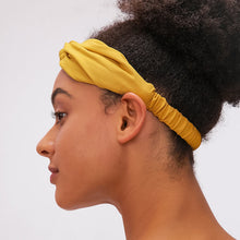 Load image into Gallery viewer, Keep bangs at bay and sweat out of eyes with this Solid Elastic Knotted Turban Headband - Yellow. This softly scrunched headband offers a secure fit to hold your hair back, and along with moisture-wicking fabric, allows you to stay fresh and focused on your workout. Perfect for all sorts of workout activities including yoga, jogging, weightlifting, cardio, dancing, hiking, spinning, skating etc. Also suitable for morning makeup and nighttime moisturizing. Lightweight, breathable, stretchy and buttery soft.