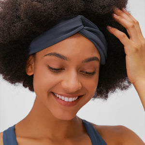Keep bangs at bay and sweat out of eyes with this Solid Elastic Knotted Turban Headband - Navy. This softly scrunched headband offers a secure fit to hold your hair back, and along with moisture-wicking fabric, allows you to stay fresh and focused on your workout. Perfect for all sorts of workout activities including yoga, jogging, weightlifting, cardio, dancing, hiking, spinning, skating etc. Also suitable for morning makeup and nighttime moisturizing. Lightweight, breathable, stretchy and buttery soft.