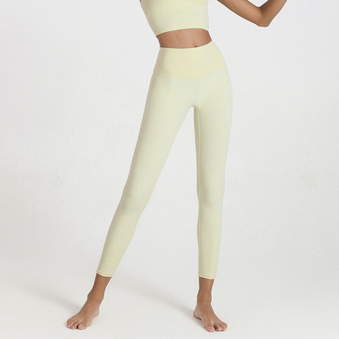 Complete the studio to street look with these Solid Hidden Pocket 7/8 Leggings - Cream. Featuring mid-rise fit with a hidden waistband phone pocket in the back, these fitted workout leggings are perfect for yoga, weight training, jogging and more, as well as running errands. Buttery soft material with a brushed feel is breathable and moisture-wicking. Complete the look with crop tops such as the Strappy Crisscross Padded Crop Tank Sports Bra or Solid Cotton Pullover Crop Hoodie.