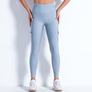 Style your gym to street look with these Solid High Waist Cargo Leggings - Pale Blue. Workout leggings with side pockets can be very useful when you want to bring your phone with you during workout, be it for a tracking fitness app, or music on the phone. These fitted cargo leggings feature four flap pockets - two on the sides and two on the back, for essentials like a phone, keys, cards etc. These capris leggings are breathable and non-see-through. Also perfect for post-gym errand running.