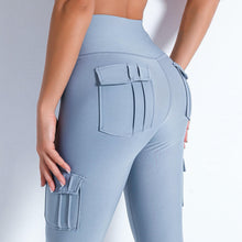 Load image into Gallery viewer, Style your gym to street look with these Solid High Waist Cargo Leggings - Pale Blue. Workout leggings with side pockets can be very useful when you want to bring your phone with you during workout, be it for a tracking fitness app, or music on the phone. These fitted cargo leggings feature four flap pockets - two on the sides and two on the back, for essentials like a phone, keys, cards etc. These capris leggings are breathable and non-see-through. Also perfect for post-gym errand running.