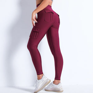 Style your gym to street look with these Solid High Waist Cargo Leggings - Burgundy. Workout leggings with side pockets can be very useful when you want to bring your phone with you during workout, be it for a tracking fitness app, or music on the phone. These fitted cargo leggings feature four flap pockets - two on the sides and two on the back, for essentials like a phone, keys, cards etc. These capris leggings are breathable and non-see-through. Also perfect for post-gym errand running.