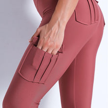 Load image into Gallery viewer, Style your gym to street look with these Solid High Waist Cargo Leggings - Black. Workout leggings with side pockets can be very useful when you want to bring your phone with you during workout, be it for a tracking fitness app, or music on the phone. These fitted cargo leggings feature four flap pockets - two on the sides and two on the back, for essentials like a phone, keys, cards etc. These capris leggings are breathable and non-see-through. Also perfect for post-gym errand running.