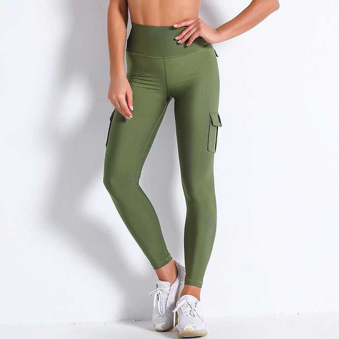 Style your gym to street look with these Solid High Waist Cargo Leggings - Moss Green. Workout leggings with side pockets can be very useful when you want to bring your phone with you during workout, be it for a tracking fitness app, or music on the phone. These fitted cargo leggings feature four flap pockets - two on the sides and two on the back, for essentials like a phone, keys, cards etc. These capris leggings are breathable and non-see-through. Also perfect for post-gym errand running.