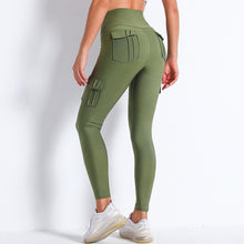 Load image into Gallery viewer, Style your gym to street look with these Solid High Waist Cargo Leggings - Moss Green. Workout leggings with side pockets can be very useful when you want to bring your phone with you during workout, be it for a tracking fitness app, or music on the phone. These fitted cargo leggings feature four flap pockets - two on the sides and two on the back, for essentials like a phone, keys, cards etc. These capris leggings are breathable and non-see-through. Also perfect for post-gym errand running.