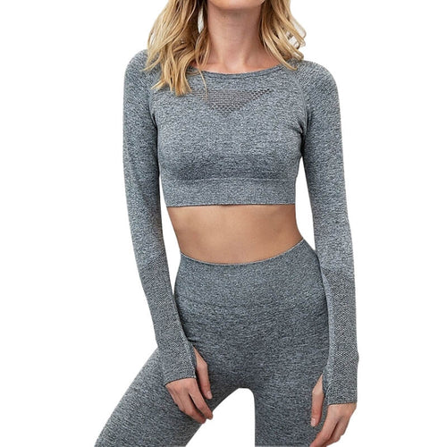 This Solid Mesh Cutout Seamless Workout Set - Leggings + Crop Top - Grey represents girls who workout - a combination of femininity and power. Raglan long sleeve crop top features an inverted triangle mesh panel on center chest, lower back cutout and thumbholes. Both the leggings and biker shorts have widened ribbed waistband. Strappy sports bra is adjustable with low cut on the back. This matching workout set is perfect for all sorts of workout activities, as well as post-exercise errand running.