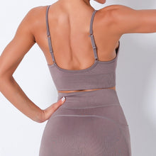 Load image into Gallery viewer, Bring Your Electronic Companion Along with this Solid Pocket Leggings & Plunge Sports Bra Set - Dusty Lavender. This workout set includes a pair of leggings and a sports bra. High waisted leggings feature a slim right side pocket and contouring ribbed panels. Right side pocket can store essentials like a phone, keys, cards etc. Plunge sports bra has two adjustable thin straps that can attach to each other, forming a crisscross.