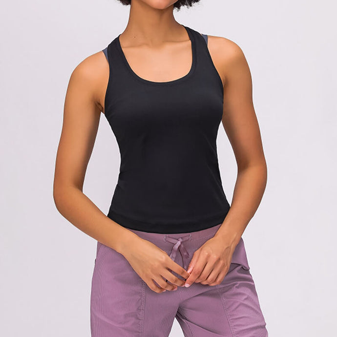 Take your active look from studio to street with this Solid Racerback Crop Tank Top - Black. Featuring scoop neckline and v neck racerback, this fitted crop tank top is ideal for all sorts of activities, be it for workouts, running errands or lounging. With a 20-23 inch / 51 - 59 cm shortened length, this cute crop tank won't get in the way during training, and is easy to layer. Designed to be worn on top of a sports bra. Complete the look with our High Waist Hidden Pocket Leggings.