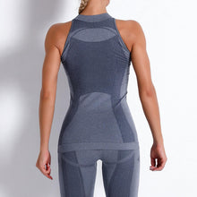 Load image into Gallery viewer, Necessitate self-discipline with this Solid Seamless Cosmo Tank & Biker Shorts Set - Charcoal. This matching workout set includes a tank top and a pair of biker shorts. Tank top has a high neck and is snugly fitted, supporting your movement as the final layer no matter what exercise you are engaging in. Biker shorts are high-waist fitted with above the knee length. Extensive and aesthetic ribbed panels accentuate your hard effort through self-discipline.