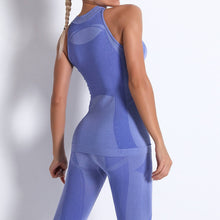 Load image into Gallery viewer, Necessitate self-discipline with this Solid Seamless Cosmo Tank & Biker Shorts Set - Blue. This matching workout set includes a tank top and a pair of biker shorts. Individual items are available for mixing and matching. Tank top has a high neck and is snugly fitted, supporting your movement as the final layer no matter what exercise you are engaging in. Biker shorts are high-waist fitted with above the knee length. Extensive and aesthetic ribbed panels accentuate your hard effort through self-discipline.