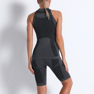 Necessitate self-discipline with this Solid Seamless Cosmo Tank & Biker Shorts Set - Black. This matching workout set includes a tank top and a pair of biker shorts. Individual items are available for mixing and matching. Tank top has a high neck and is snugly fitted, supporting your movement as the final layer no matter what exercise you are engaging in. Biker shorts are high-waist fitted with above the knee length. Extensive and aesthetic ribbed panels accentuate your hard effort through self-discipline.