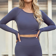 Load image into Gallery viewer, An ideal athletic outfit for inside and outside of the gym can be as simple as this Solid Seamless Crop Top - Charcoal. Raglan sleeve crop top features long ribbed cuffs and thumbholes. Leggings are high waisted with wide a compressive waistband. Aesthetic and subtle ribbed panels accentuate your body curves. This cute 2 piece matching workout set is perfect for all sorts of indoor and outdoor activities such as weight training, jogging, bar workout and more.
