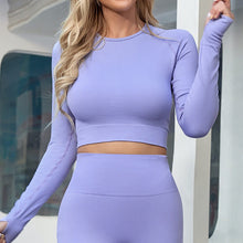 Load image into Gallery viewer, An ideal athletic outfit for inside and outside of the gym can be as simple as this Solid Seamless Crop Top - California Lilac. Raglan sleeve crop top features long ribbed cuffs and thumbholes. Leggings are high waisted with wide a compressive waistband. Aesthetic and subtle ribbed panels accentuate your body curves. This cute 2 piece matching workout set is perfect for all sorts of indoor and outdoor activities such as weight training, jogging, bar workout and more.
