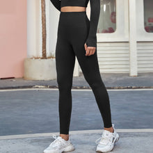Load image into Gallery viewer, An ideal athletic outfit for inside and outside of the gym can be as simple as this Solid Seamless High Waist Leggings - Ink Black. Raglan sleeve crop top features long ribbed cuffs and thumbholes. Leggings are high waisted with wide a compressive waistband. Aesthetic and subtle ribbed panels accentuate your body curves. This cute 2 piece matching workout set is perfect for all sorts of indoor and outdoor activities such as weight training, jogging, bar workout and more.