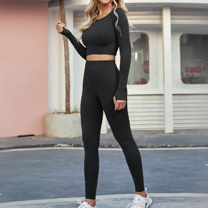 An ideal athletic outfit for inside and outside of the gym can be as simple as this Solid Seamless Leggings & Crop Top Set - Ink Black. Raglan sleeve crop top features long ribbed cuffs and thumbholes. Leggings are high waisted with wide a compressive waistband. Aesthetic and subtle ribbed panels accentuate your body curves. This cute 2 piece matching workout set is perfect for all sorts of indoor and outdoor activities such as weight training, jogging, bar workout and more.