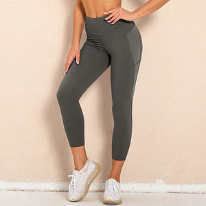 Bring your electronic companion along with this Solid Side Mesh Leggings with Pockets - Grey. Workout leggings with side pockets can be very useful when you want to bring your phone with you during workout. These high waisted gym leggings feature mesh side pockets, with mesh panels extending to ankles. Side pockets can store essentials like a phone, keys, cards etc. These gym-to-street capris leggings are breathable, moisture-wicking and non-see-through.