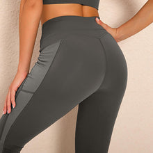 Load image into Gallery viewer, Bring your electronic companion along with this Solid Side Mesh Leggings with Pockets - Grey. Workout leggings with side pockets can be very useful when you want to bring your phone with you during workout. These high waisted gym leggings feature mesh side pockets, with mesh panels extending to ankles. Side pockets can store essentials like a phone, keys, cards etc. These gym-to-street capris leggings are breathable, moisture-wicking and non-see-through.