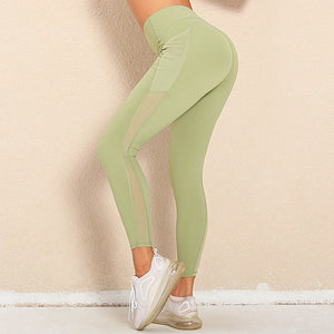 Bring your electronic companion along with this Solid Side Mesh Leggings with Pockets - Lime. Workout leggings with side pockets can be very useful when you want to bring your phone with you during workout. These high waisted gym leggings feature mesh side pockets, with mesh panels extending to ankles. Side pockets can store essentials like a phone, keys, cards etc. These gym-to-street capris leggings are breathable, moisture-wicking and non-see-through.