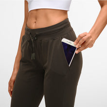 Load image into Gallery viewer, These Solid Slim Fit Drawstring Joggers - Obsidian are great for either in studio, at the gym, work at home or on the go. Featuring mid-rise, slim fit and adjustable drawstring, these cuffed joggers are as versatile as they are comfortable. Open deep pockets can store essentials like a phone, keys, cards etc. Buttery soft material is breathable, moisture-wicking and dries quickly. Perfect for yoga, cardio, jogging as well as errand running and lounging. Complete the look with a crop top or crop tank.