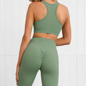 This Solid Booty Scrunch Leggings Set - Olive Green is made for your favorite medium-impact workouts. The sports bra offers flattering v-neck silhouette. Widened underband at center front and tall sides, as well as racerback design provides additional support. A pair of booty scrunch leggings is high waisted fit, accentuating mid to lower body curves. This Solid Booty Scrunch Leggings Set is made of moisture-wicking, soft and stretchy fabric. Perfect for all sorts of workout activities.