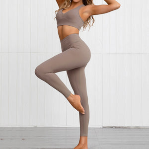 This Solid Booty Scrunch Leggings Set - Coffee Brown is made for your favorite medium-impact workouts. The sports bra offers flattering v-neck silhouette. Widened underband at center front and tall sides, as well as racerback design provides additional support. A pair of booty scrunch leggings is high waisted fit, accentuating mid to lower body curves. This Solid Booty Scrunch Leggings Set is made of moisture-wicking, soft and stretchy fabric. Perfect for all sorts of workout activities.
