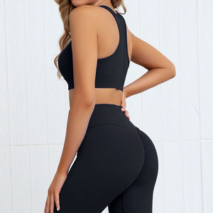 This Solid Booty Scrunch Leggings Set - Ink Black is made for your favorite medium-impact workouts. The sports bra offers flattering v-neck silhouette. Widened underband at center front and tall sides, as well as racerback design provides additional support. A pair of booty scrunch leggings is high waisted fit, accentuating mid to lower body curves. This Solid Booty Scrunch Leggings Set is made of moisture-wicking, soft and stretchy fabric. Perfect for all sorts of workout activities.