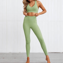 Load image into Gallery viewer, This Solid Booty Scrunch Leggings Set - Matcha Green is made for your favorite medium-impact workouts. The sports bra offers flattering v-neck silhouette. Widened underband at center front and tall sides, as well as racerback design provides additional support. A pair of booty scrunch leggings is high waisted fit, accentuating mid to lower body curves. This Solid Booty Scrunch Leggings Set is made of moisture-wicking, soft and stretchy fabric. Perfect for all sorts of workout activities.