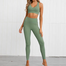 Load image into Gallery viewer, This Solid Booty Scrunch Leggings Set - Olive Green is made for your favorite medium-impact workouts. The sports bra offers flattering v-neck silhouette. Widened underband at center front and tall sides, as well as racerback design provides additional support. A pair of booty scrunch leggings is high waisted fit, accentuating mid to lower body curves. This Solid Booty Scrunch Leggings Set is made of moisture-wicking, soft and stretchy fabric. Perfect for all sorts of workout activities.