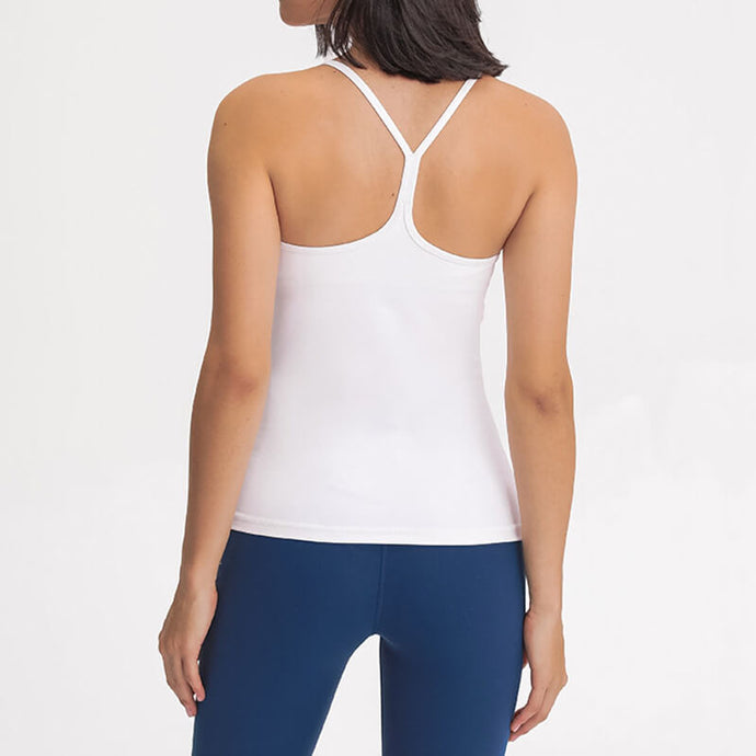 Move freely and enjoy the convenience brought by this Solid Y Racerback Padded Tank Top - White. Featuring thin straps and racerback silhouette, this padded tank is perfect for low impact activities from studio to gym, to daily lounging. The length is just right that it won't get in the way during your asanas or weight training. Buttery soft and breathable fabric makes it comfortable to wear all day long.
